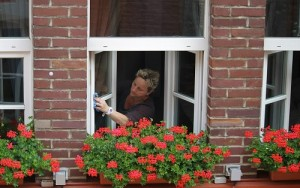 a man cleaning a window