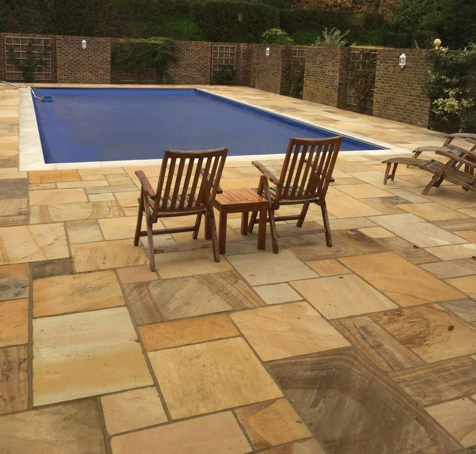 indian sandstone patio with a swimming pool