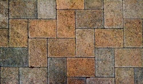 Multi-coloured herringbone block paving