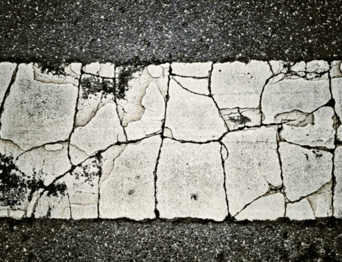 What causes a cracked driveway?